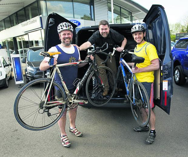 thisisoxfordshire: Cyclists Mark Crick and Neil Barson with pub landlord Steve Davidson, centre