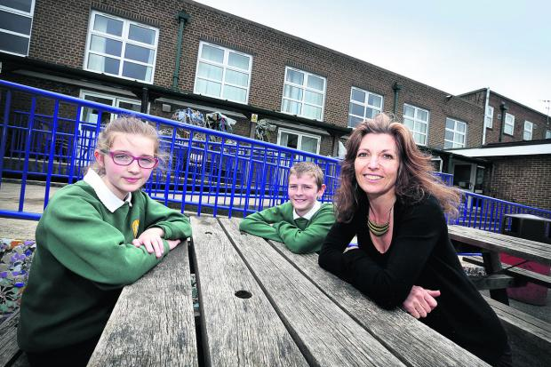 thisisoxfordshire: Windmill Primary School headteacher, Lynn Knapp outside the school hall with pupils, Eliza Ellis and Mason Pullen