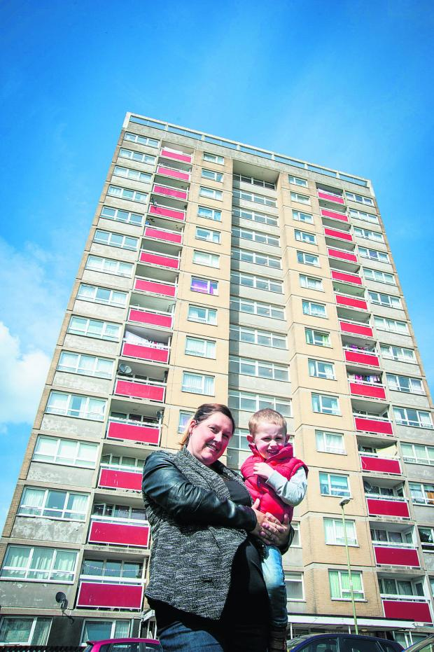 thisisoxfordshire: Lauraine Dineen with son Harry, three, outside Evenlode Tower. Picture: OX66778 Aimee Kirkham