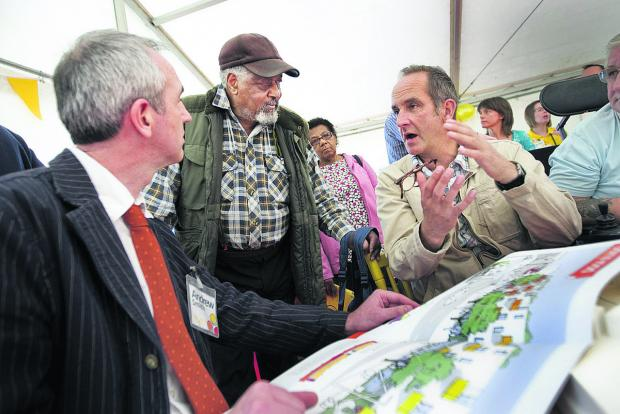 thisisoxfordshire: Kevin McCloud, right, with Andrew Smith of housing group GreenSquare speaking to resident Arthur Preddie about the development in 2011