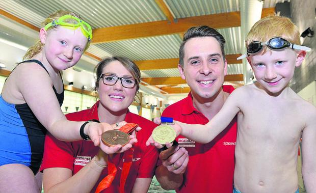 Participating in the Swim Tour at Barton Leisure Centre in Oxford, were, left to right, Catrin Rawstorne, eight, Olympic Bronze medalist Cassie Patten, Commonwealth Gold medalist Adam Whitehead and Owen Rawstorne, six, from Oxford