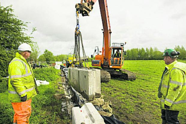 Flood barriers are removed at South Hinksey