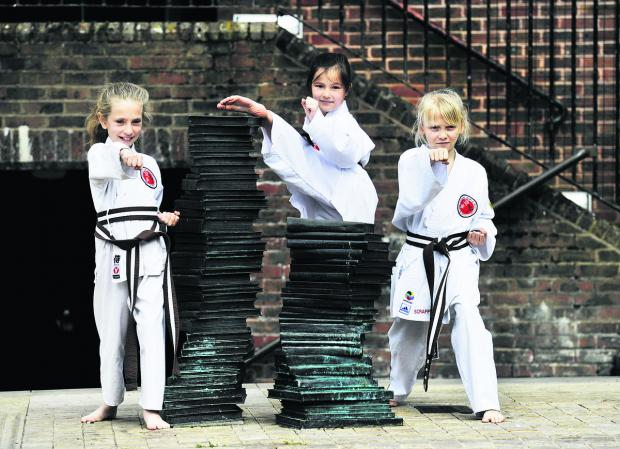 thisisoxfordshire: From left, Lara Plested, eight, Chloe Wood, nine, and Alisha Pitts, 10 show off their martial arts skills