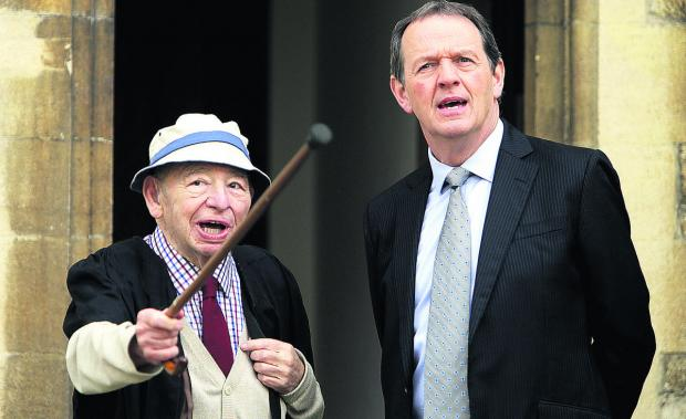 Author Colin Dexter, left, admires the setting at St Edmund Hall with Kevin Whately (DI Lewis) as they prepare to shoot a scene for the new series of the popular Inspector Morse TV spin-off, Lewis