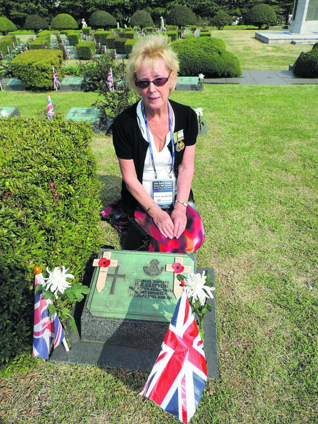 thisisoxfordshire: Val Busby at the graveside in South Korea of her uncle Herbert Clifton