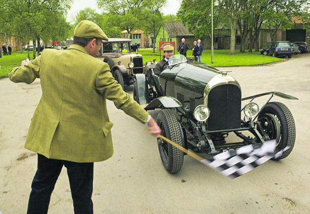 thisisoxfordshire: Ewen Getley gets waved off in his 1924 three-litre Bentley