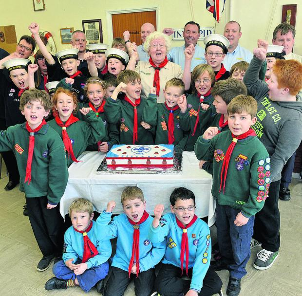 thisisoxfordshire: Beavers, Cubs and Scouts give a cheer at the reopening of the refurbished 1st Bicester Scout HQ, along with Scout leaders and DHL staff