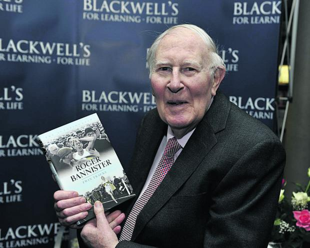 Sir Roger Bannister with a copy of his autobiography Twin Tracks last month.  Picture: OX66519 Mark Hemsworth