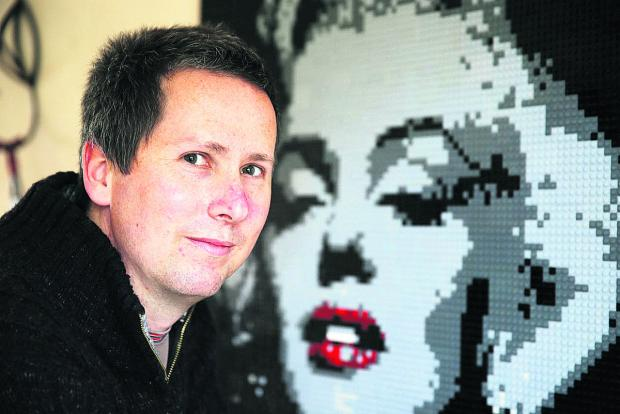 thisisoxfordshire: Alastair Howard with his portrait of Marilyn Monroe made of Lego.  Picture: OX66900 Damian Halliwell