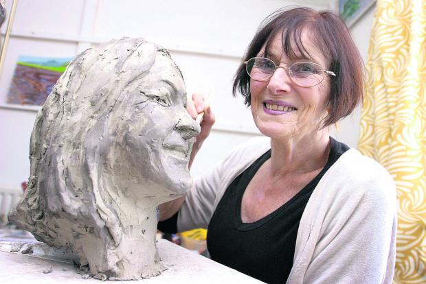 Victoria Hallam works on a sculpture of her daughter Jane