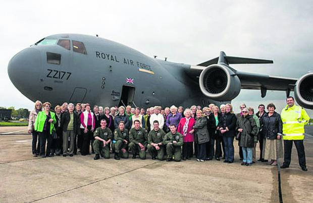 thisisoxfordshire: West Witney WI members pictured in front of one of 99 Squadron's C17s with some of the crew.