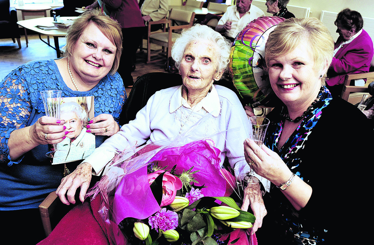 BIG DAY: Vi Davies celebrates her 100th birthday with daughters Alison New, left, and Carol Mills