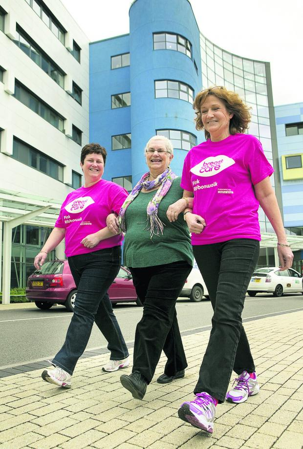 thisisoxfordshire: From left, Jane Coles, Angela Robinson, Julia Goodgame step out for the Pink Ribbonwalk Picture: OX66942 Antony Moore