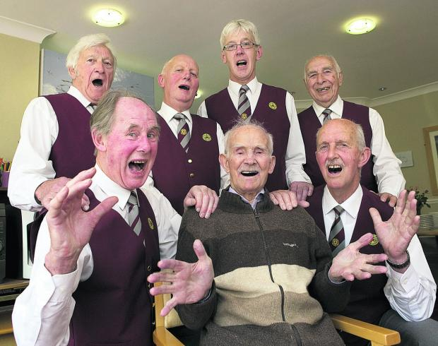 David 'Haydn' Cooper, front centre, joins current members of the Oxford Welsh Male Voice Choir – back from left, Ron Salter, Derek Straughair, George Jenkinson and Vic Merry, and, front, Philip Bunce, left, and Malcolm Hookham in a singalong at the