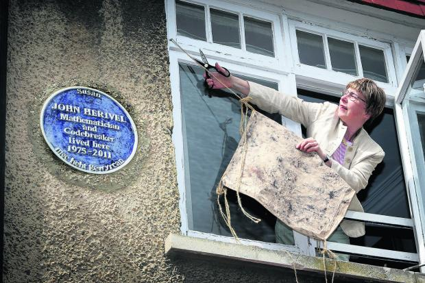 Susan Herivel unveils the blue plaque she made in memory of her father, John Herivel