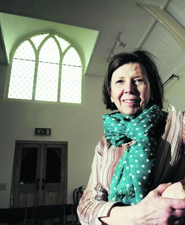 Maggie Rawcliffe with the restored window