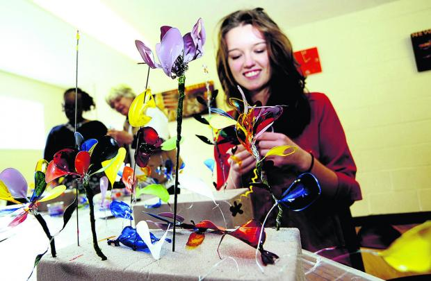 thisisoxfordshire: Hayley Wilkinson, 16, has a go at making artificial flowers at the OSCAR event