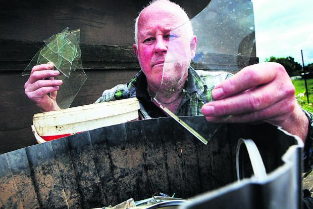 David Webster inspects some of the damage at his greenhouse on the Elder Stubbs Allotment