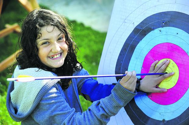 thisisoxfordshire: Maya Finlayson, 10, scores a perfect bullseye in the archery session 	      Picture: OX67121 Jon Lewis