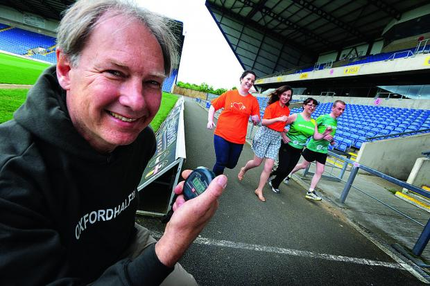 thisisoxfordshire: Race director Andrew Taylor with, from left, Poppy Hanbury and Kate Sankey of Helen & Douglas House, and Erika Dallimore and Damon Boughen of Oxfam.  Picture: OX67204 Jon Lewis