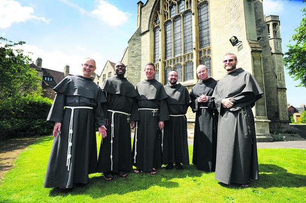 thisisoxfordshire: From left, Friar Matthew, Friar Benedict, Brother Daniel, Friar Gerard Mary, Friar James Mary and Friar Maximillian outside All Saints Convent