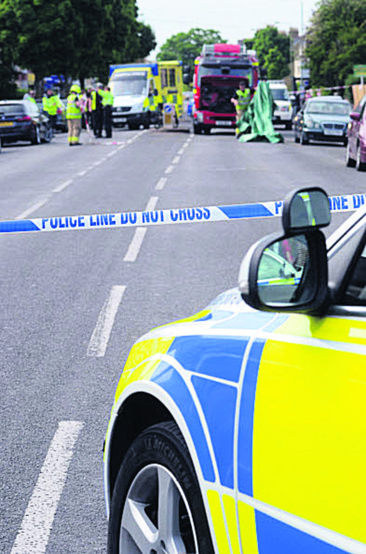 Police at the scene of the Cowley Road crash