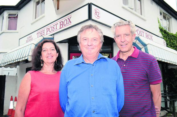 thisisoxfordshire: Alison Morris, Steve Lunn, centre, and Phillip Dove from Wolvercote Community Benefit Society outside the shop