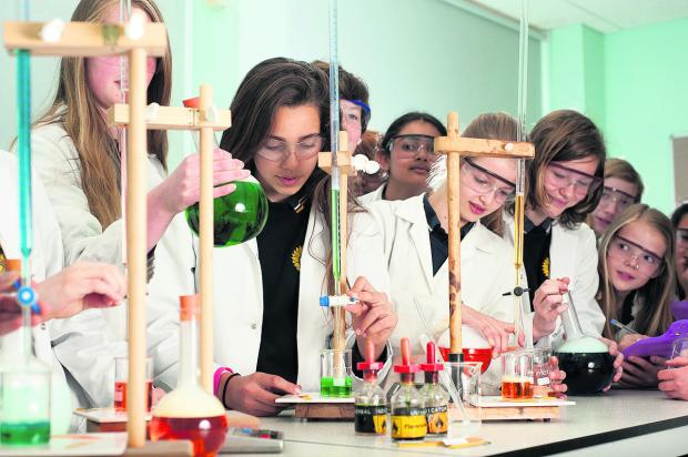 Girls at Oxford High School, including Belle Albert, second from left, will head to L'Oreal in London to test shampoos and question its science director