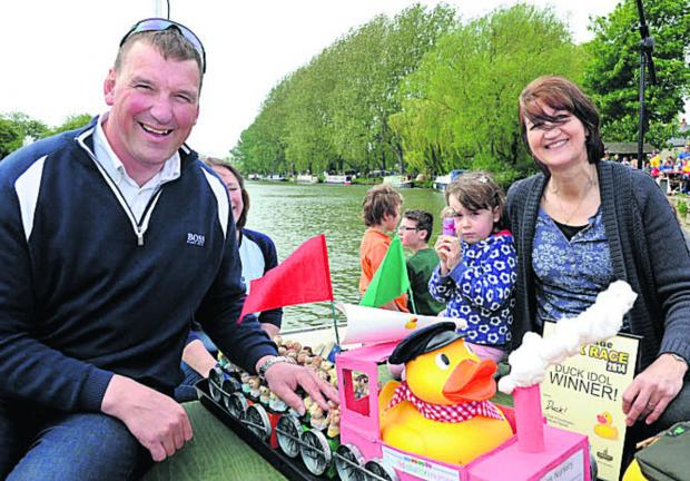 thisisoxfordshire: Sir Matthew Pinsent with Lucy Agg and Louise Jenkins, from Filkins Nursery, with their decorated duck, which won a contest at the event 	Pictures: Richard Pasco