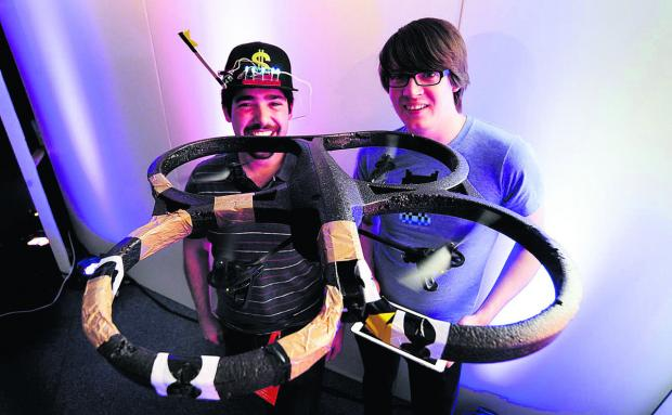 thisisoxfordshire: Francis Gulotta, left, and Andrew Nesbitt, with one of their flying robots which can be operated by a hoodie