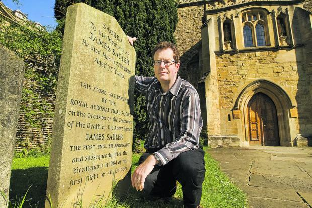 Richard O. Smith by the grave of James Sadler, inset, in Merton Fields.  Pictures: OX67301 Antony Moore
