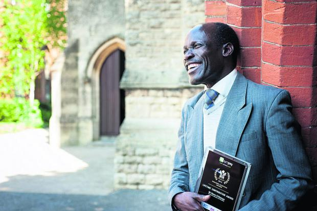 Henry Chitsenga with his Lifetime Outstanding Contribution award in the Zimbabwe Achievers Awards