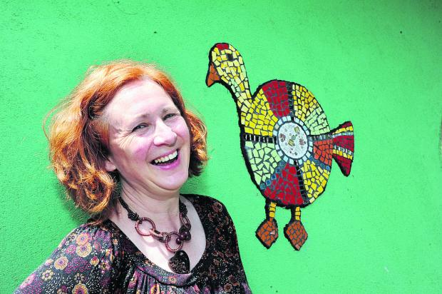 Artist Clare Goodall with one of the mosaics created by families at Florence Park Children's Centre to celebrate the Cowley park's 80th anniversary