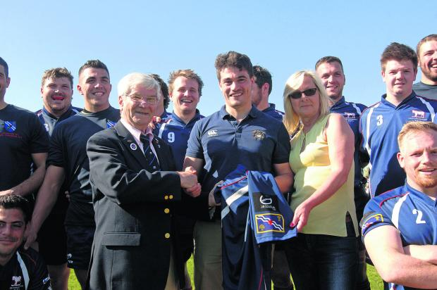 thisisoxfordshire: Oxfordshire RFU president Ken Bumpass receives a county shirt sponsored by the Jim Douglas Memorial Fund from the late Harwell player's son Rob (centre) and partner Mandy Evans. It was the Douglas family's wish to support Oxfordshire rugby and put the