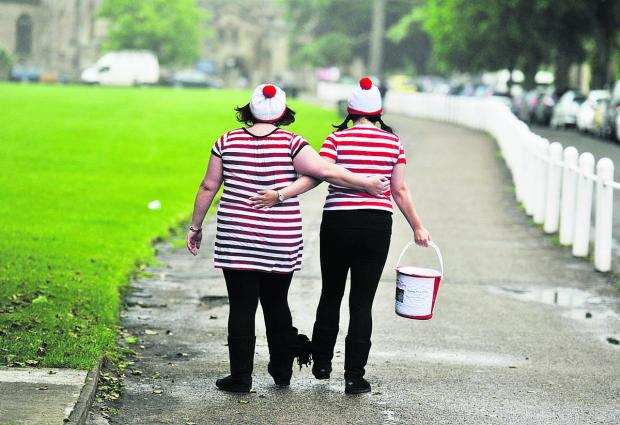 thisisoxfordshire: Nikki Lane, left, and Nadine Ludlow completed a three-legged walk