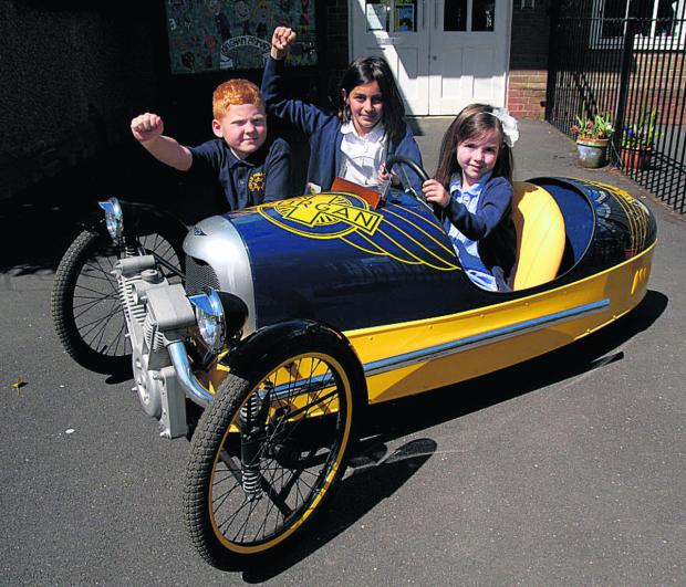 From left, Rex Chiles, seven, Maya Rees, 10, and Poppy Rooney, four, try the Morgan pedal car for size