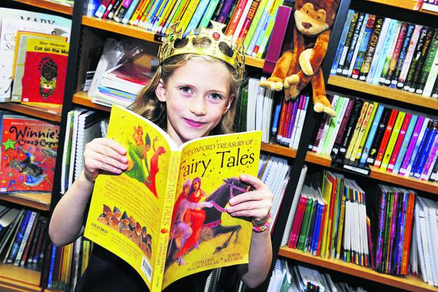 thisisoxfordshire: Eight-year-old Charlotte Redman gets stuck in to a book of fairy tales. Pictures: OX67496 Mark Hemsworth