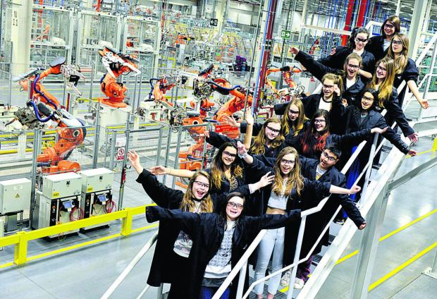 The dancers meet some of the 1,000 robots at the Mini plant in Cowley