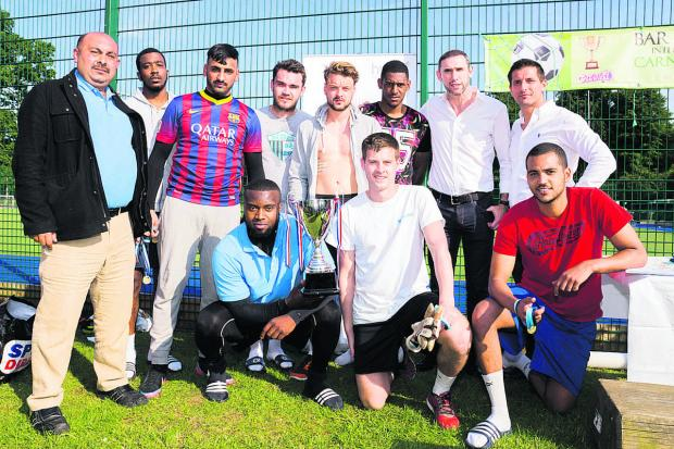 thisisoxfordshire: Former Arsenal footballer, Martin Keown, back row, second right, and event organiser Xhetan Bushi, back row, right, with the Oxford FCB team.  Picture: OX67484 Greg Blat
