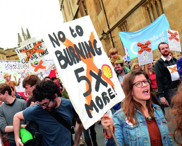 thisisoxfordshire: The march through Oxford city centre to protest about the use of fossil fuels and call on county firms to stop investing in fossil fuel companies