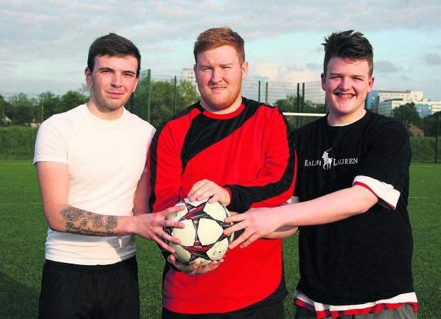 Barton players Ciaran Vinten, left, and Jack Plumber,  right, with Cutteslowe's Kevin Smith. Picture: OX67548  Steve Wheeler