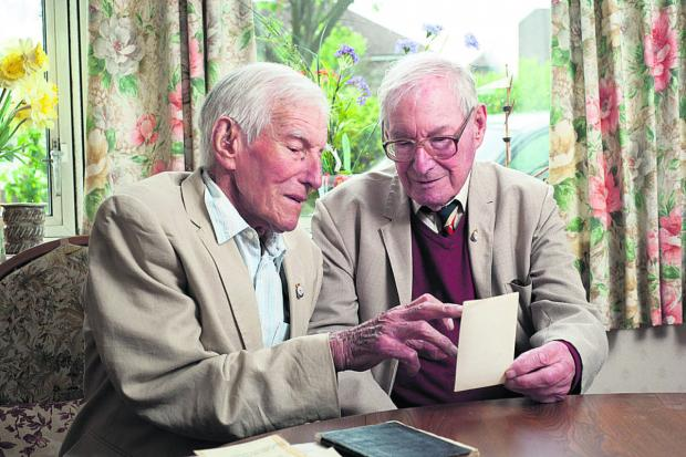thisisoxfordshire: Stan Rhymes, 90, and Bill Rhymes, 92, look at documents and photographs from the run-up to D-Day