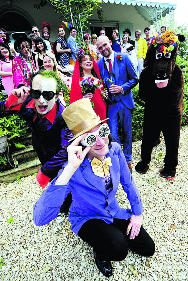 thisisoxfordshire: Shady characters: Chloe Horner married her partner Tom Sharp, centre, with a guest list, including a who's who of fictional and true life characters. Front from left, Lee Christian as Prince-Party Man and Paul Bonham as Willy Wonka