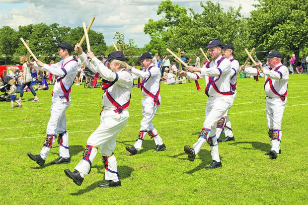 thisisoxfordshire: Headington Quarry Morris Dancers put on a display at the fete