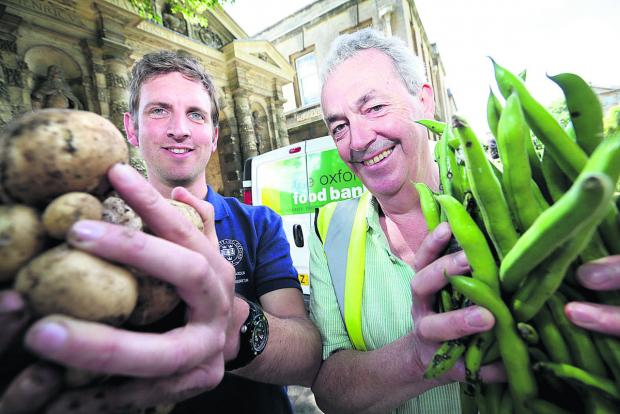 Garden curator Tom Price, left, with Oxford Food Bank co-founder Robin Aitken
