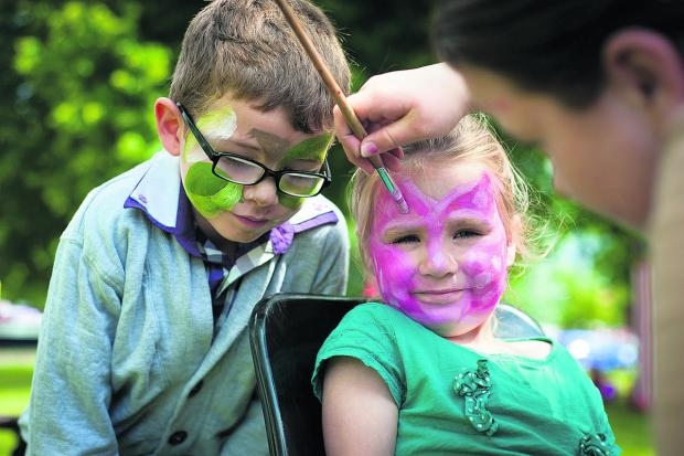thisisoxfordshire: Danny Rooney, eight and Amy Dallimore, 3, enjoy the face painting.  Picture: OX67875 Andrew Walmsley