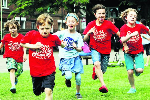 thisisoxfordshire: From left, six-year-olds Milo Spiller, Otto Rourke and Alex Molduano, and eight-year-olds Zinzi Spiller and Elspeth Bailey get in some practice for Run Jericho outside St Barnabas Primary School.  Picture: OX67869 Ed Nix
