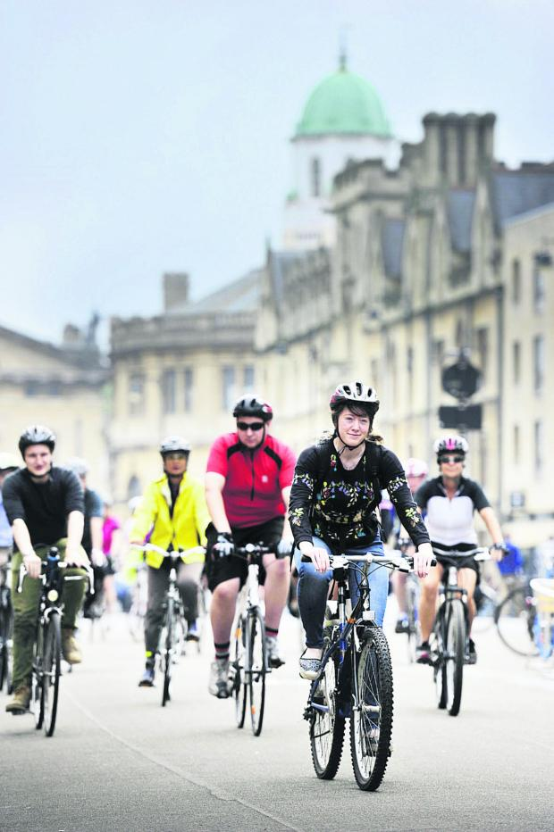 thisisoxfordshire: PEDAL POWER: Jennie Williams leads the cyclists down Broad Street in Oxford
