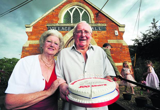 thisisoxfordshire: Tony and Ann Allsworth with the village hall birthday cake