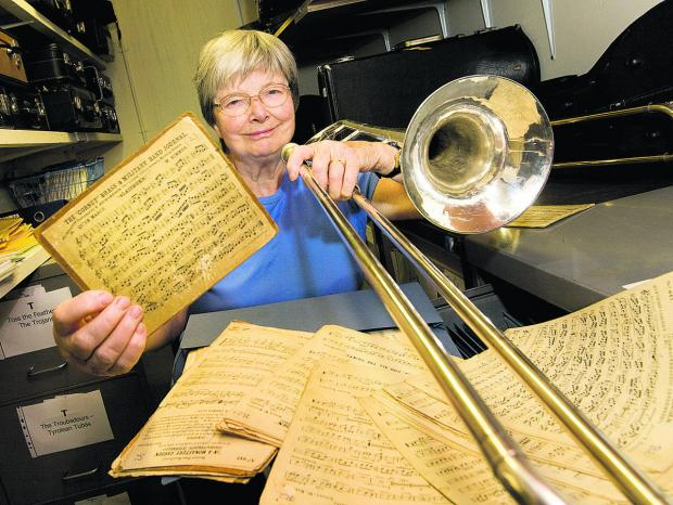 Caroline Dalton, librarian with The City of Oxford Silver Band, with old instruments and sheet music belonging to the group. Picture: OX67846 Antony Moore
